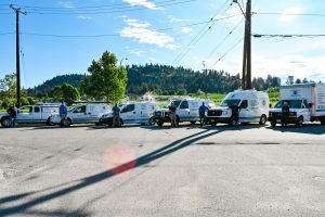 Living Water - Commercial Plumbing Kelowna - Workers Group Photo in Front of Vehicles