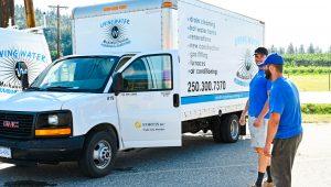 Living Water - Commercial Plumbing Kelowna - Two People Talking Beside a Truck