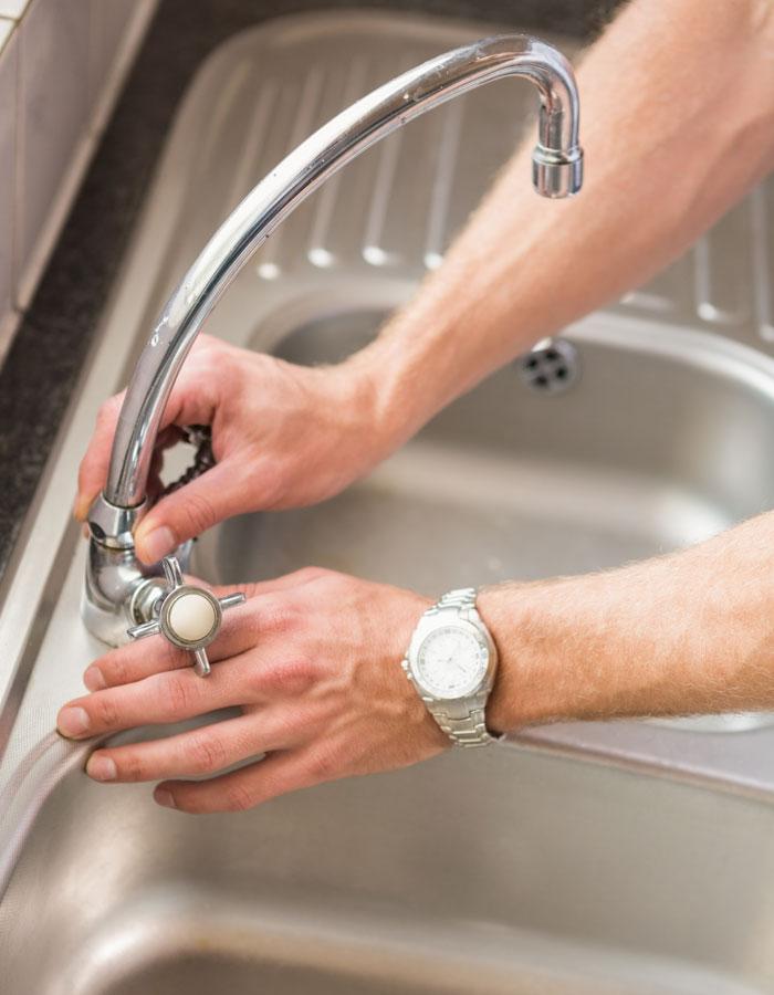 living_water_mechanical_kelowna_plumbing_company_checking_kitchen_sink